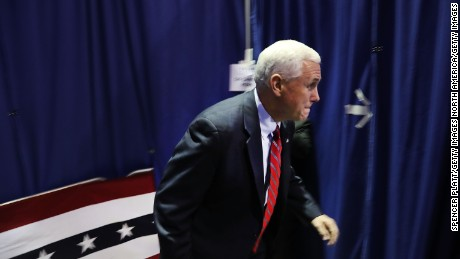 MARIETTA, OH-Republican Vice Presidential Candidate Mike Pence runs onto stage at a rally on October 25, 2016 in Marietta, Ohio. Ohio has become one of the key battleground states in the 2016 presidential election with both candidates or their surrogates making weekly visits to the Buckeye State. Unlike other parts of America, Ohio has both a rapidly aging and declining population as well as a high degree of residents without a college education.  (Photo by Spencer Platt/Getty Images)