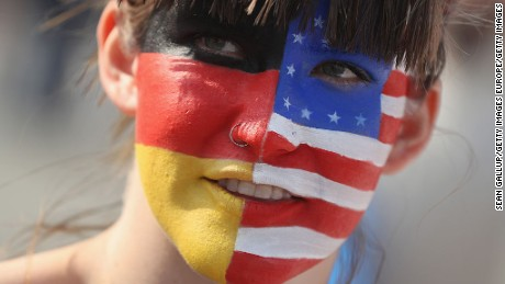 BERLIN, GERMANY - SEPTEMBER 23:  A young woman protesting against Republican U.S. elections candidate Donald Trump wears the German and U.S. flags on her face at a small anti-Trump event on September 23, 2016 in Berlin, Germany. The organizer of the event, Avaaz, was seeking to encourage U.S. citizens abroad to vote in upcoming U.S. elections that will decide whether Trump or Democrat candidate Hillary Clinton becomes the next president of the United States.  (Photo by Sean Gallup/Getty Images)