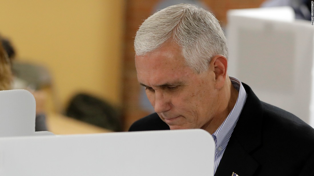 Trump's running mate, Indiana Gov. Mike Pence, votes in Indianapolis.