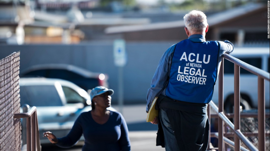 A Legal Observer With The American Civil Liberties Union Of Nevada Stands At The Entrance Of