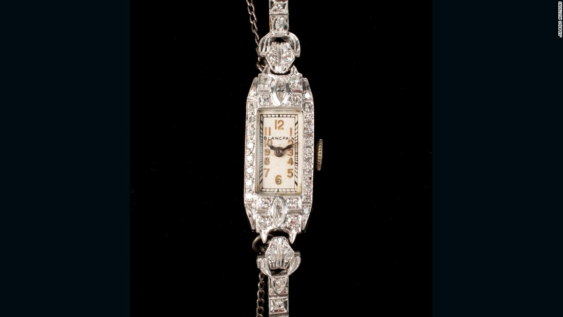 The auction will continue until Nov. 19. Remaining items include this diamond Art Deco watch.