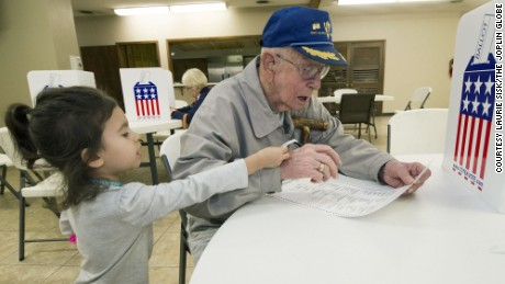 WWII veteran Harvey Erwin, 94, votes Tuesday with his great-granddaughter in Joplin, Missouri.
