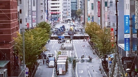 A giant sinkhole has opened up in Fukuoka, Japan, swallowing huge sections of road including traffic lights, near to underground work to extend a subway tunnel.  Will Barker was close to Hakata Station and captured this image, showing emergency vehicles blocking access to the road.  He told CNN: The hole was interesting, so I went to investigate.