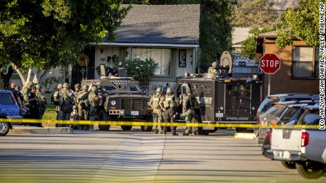 SWAT team moves in on a barricaded suspect on Fourth Street east of Orange Avenue after several people were shot at that location in Azusa, Calif., Tuesday, Nov. 8, 2016. The shooting occurred near a polling site; and elections officials say one other polling site was affected, urging voters to cast their ballots in other locations. Azusa police say arriving officers found multiple victims, came under fire and returned fire themselves. (Leo Jarzomb/San Gabriel Valley Tribune/SCNG via AP)