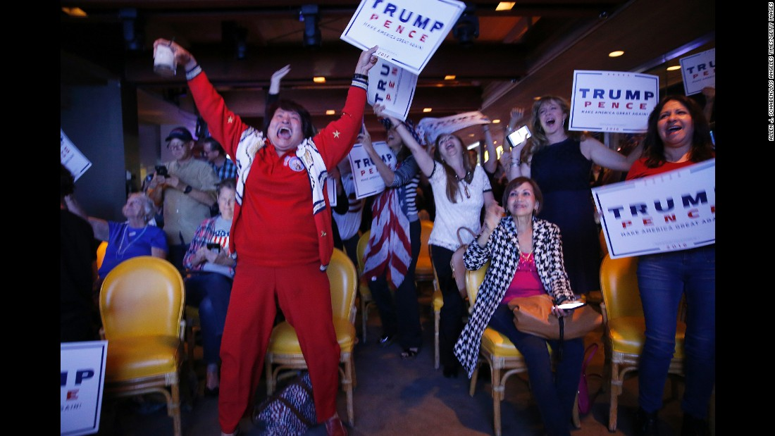 Republicans in Newport Beach, California, erupt in celebration as Trump's victory in Florida is announced.