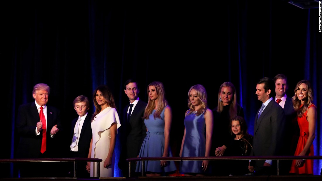"Trump, on stage with his family, acknowledges the crowd at the New York Hilton Midtown Hotel. He was gracious toward his opponent, Hillary Clinton, and called for unity. ""We owe (Clinton) a very major debt of gratitude to her for her service to our country,"" Trump said. ""I say it is time for us to come together as one united people."""