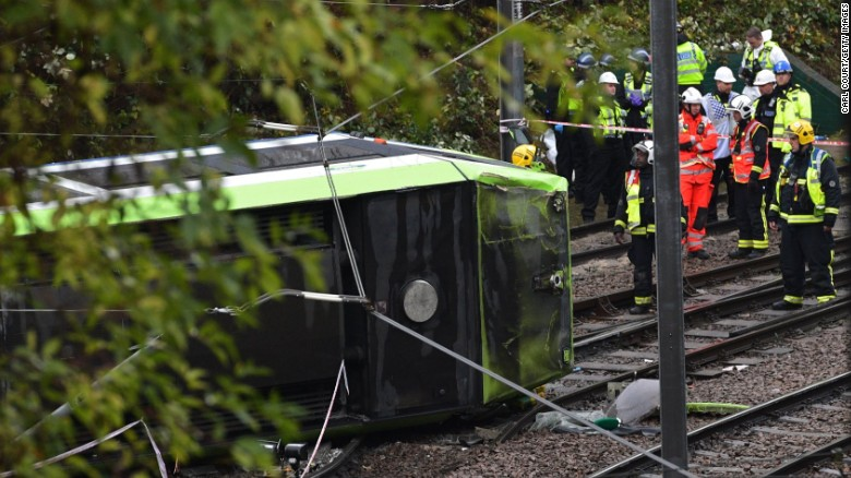 Emergency responders look at the overturned tram in Croydon, south London, on Wednesday.