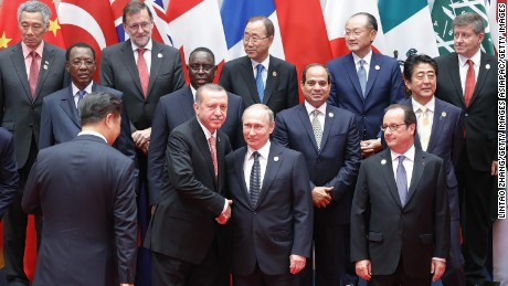 HANGZHOU, CHINA - SEPTEMBER 04:  Russian President Vladimir Putin shakes hands with Turkish President Recep Tayyip Erdogan before a group photo at the Hangzhou International Expo Center to the G20 Summit on September 4, 2016 in Hangzhou, China. World leaders are gathering in Hangzhou for the 11th G20 Leaders Summit from September 4 to 5.  (Photo by Lintao Zhang/Getty Images)