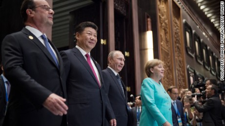 HANGZHOU, CHINA - SEPTEMBER 4:  (L-R) French President Francois Hollande, Chinese President Xi Jinping, Russia's President Vladimir Putin and German Chancellor Angela Merkel arrive for the opening ceremony of the G20 Leaders Summit on September 4, 2016 in Hangzhou, China. World leaders are gathering for the 11th G20 Summit from September 4-5. (Photo by Nicolas Asfouri - Pool/Getty Images)