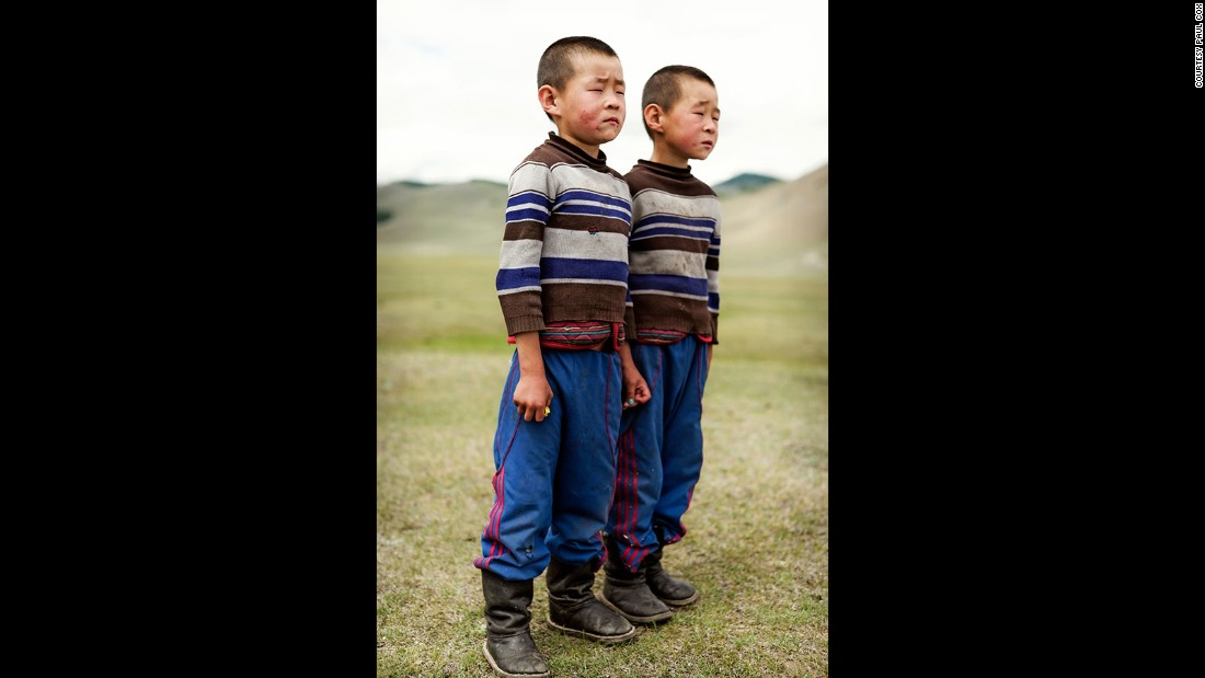 """These twins and their mom basically appeared in the middle of nowhere, when my vehicle broke down on the way to the Siberian border. Sometimes the opportunities to photograph just come to us."""
