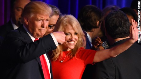 Republican presidential candidate Donald Trump falnked by campaign manager Kellyanne Conway waves to supporters following an address during election night at the New York Hilton Midtown in New York on November 9, 2016.
