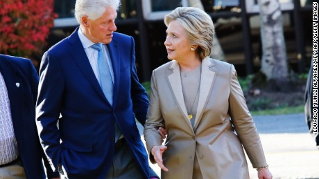 Democratic presidential nominee Hillary Clinton talks with her husband, and former President Bill Clinton after casting their votes in Chappaqua, New York on November 8, 2016. / AFP / EDUARDO MUNOZ ALVAREZ        (Photo credit should read EDUARDO MUNOZ ALVAREZ/AFP/Getty Images)