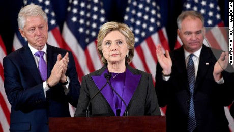 US Democratic presidential candidate Hillary Clinton makes a concession speech after being defeated by Republican presidential-elect Donald Trump as her running-mate Tim Kaine(R) and former president Bill Clinton look on in New York on November 9, 2016. / AFP / JEWEL SAMAD        (Photo credit should read JEWEL SAMAD/AFP/Getty Images)