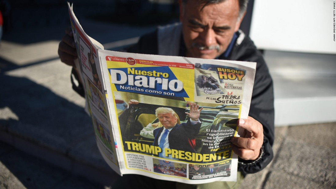 A man reads a newspaper proclaiming Trump's victory in Guatemala City, Guatemala, on November 9.