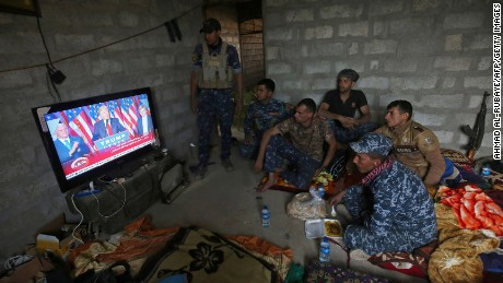 Members of the Iraqi forces in Mosul watch Donald Trump giving a speech after he won the US president elections.