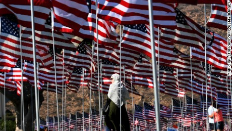 A woman wearing a hijab stands amongst US national flags erected by students and staff from Pepperdine University as they pay their respects to honor the victims of the September 11, 2001 attacks in New York, at their campus in Malibu, California on September 10, 2016.  The students placed aound 3,000 flags in the ground in tribute to the nearly 3,000 victims lost in the attacks almost 15 years ago.  / AFP / Mark RALSTON        (Photo credit should read MARK RALSTON/AFP/Getty Images)