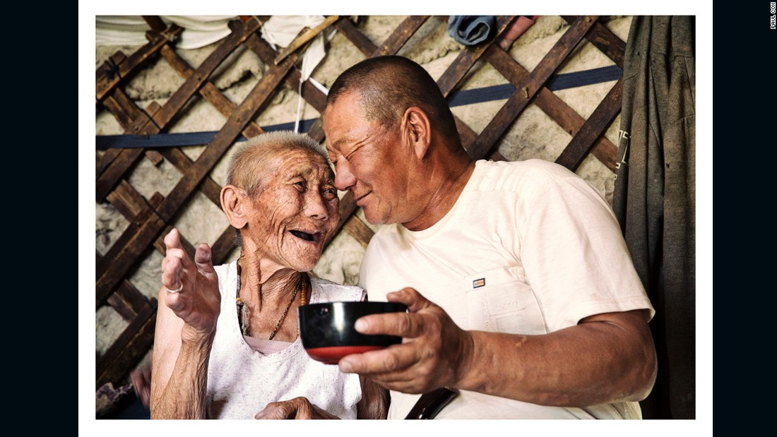 """A grandmother and grandson share a warm moment after singing traditional folk songs."""