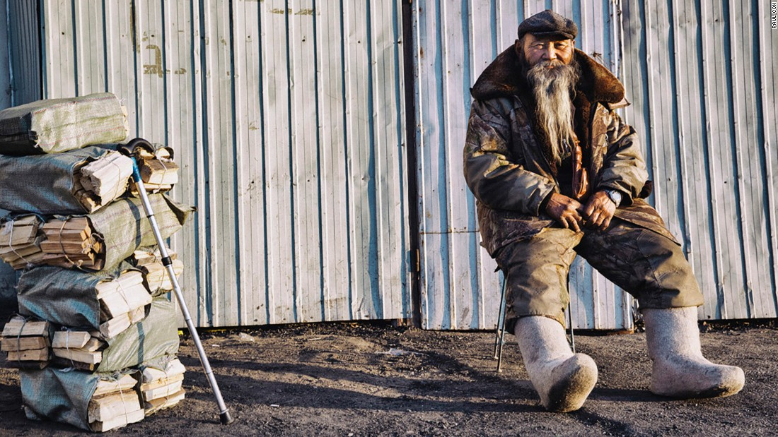 "Since 2014, Photographer Paul Cox has been dedicated to capturing portraits of life in Mongolia's poor city districts. Scroll through the gallery and read his thoughts on his work: <br /><br />""It's winter, -15 degrees Celsius, and his pure woolen boots were there to keep him warm. He was selling wood. The winter of Ulaanbaatar is very polluted with all the coal and wood burning."""
