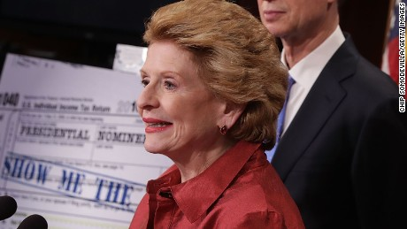 Senate Finance Committee members (L-R) Sen. Debbie Stabenow (D-MI), Sen. Ron Wyden (D-OR) and Sen. Ben Cardin (D-MD) hold a news conferene to call on Republicans to hold a vote on the Presidential Tax Transparency Act at the U.S. Capitol September 22, 2016 in Washington, DC.