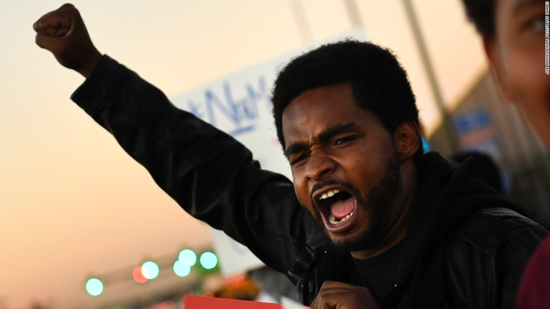 Charles Watkins speaks out at an anti-Trump protest in Denver on November 9.