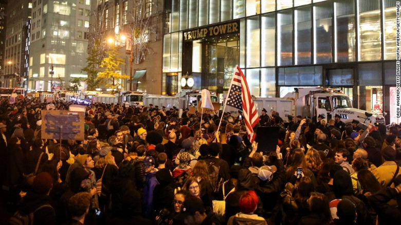 NEW YORK, NY - NOVEMBER 9: Hundreds of protestors rally against Donald Trump outside of Trump Tower, November 9, 2016 in New York City. Republican candidate Donald Trump won the 2016 presidential election in the early hours of the morning in a widely unforeseen upset. (Photo by Drew Angerer/Getty Images)