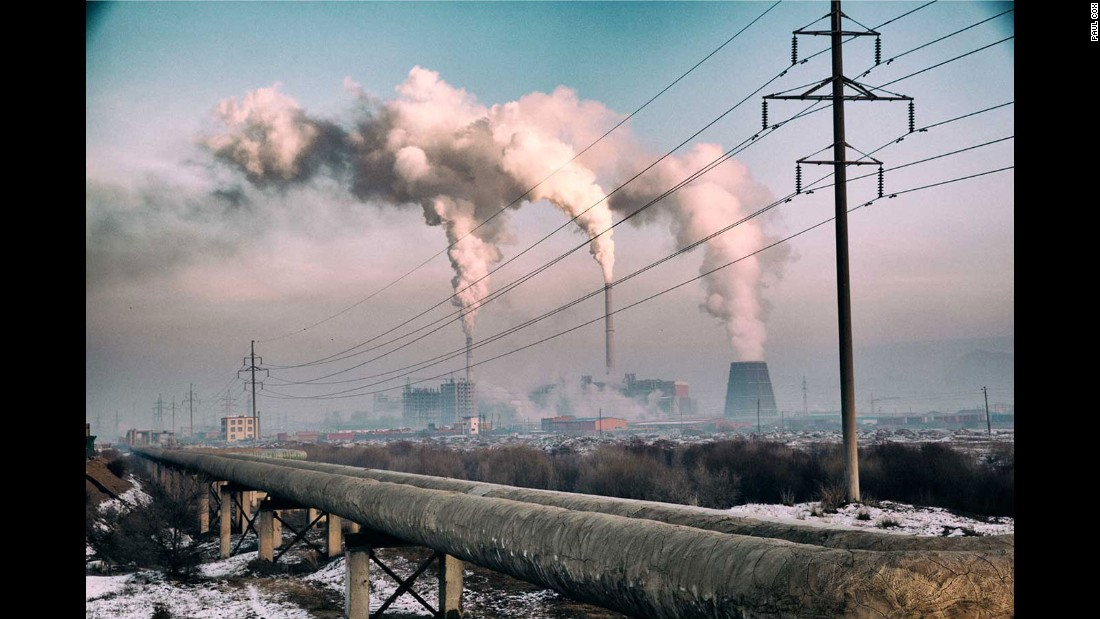 """Here, a power station heats water and circulates warmth to the city -- like some massive radiator center heating system.  At -20 degrees Celsius, water needs warming in order to circulate. The pollution is evident, and a stark contrast to the clean environment that is widely seen outside of the city."""