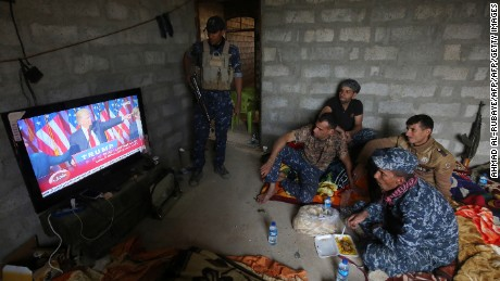 Members of the Iraqi forces watch Donald Trump giving a speech after he won the US president elections in the village of Arbid on the southern outskirts of Mosul on November 9, 2016, as they rest in a house during the ongoing military operation to retake Mosul from the Islamic State (IS) group.   Iraqi Prime Minister Haider al-Abadi congratulated Donald Trump on his election as president and said he hoped for continued US and international support in the war against jihadists.   / AFP / AHMAD AL-RUBAYE        (Photo credit should read AHMAD AL-RUBAYE/AFP/Getty Images)