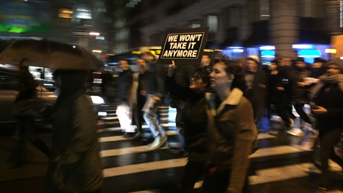 Thousands march down Fifth Avenue in New York on November 9. Authorities estimated as many as 5,000 people protested Trump's victory outside Trump Tower.