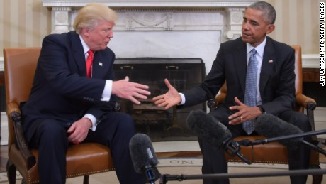 US President Barack Obama shakes hands as he meets with Republican President-elect Donald Trump on transition planning in the Oval Office at the White House on November 10, 2016 in Washington,DC.  / AFP / JIM WATSON        (Photo credit should read JIM WATSON/AFP/Getty Images)