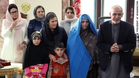 Afghanistan's President Ashraf Ghani met with Sharbat Gula, in blue, on Wednesday after she arrived in Kabul.