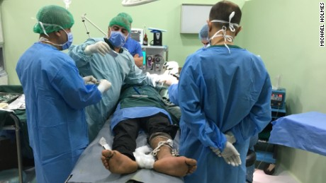 An injured man is treated by surgeons at al Shikan hospital.