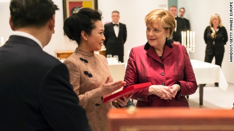 Peng Liyuan meets German Chancellor Angela Merkel wearing one of Ma Ke's designers on March 28, 2014.