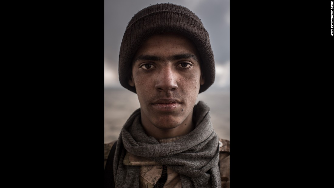A fighter from a local tribe poses for a portrait in Qayyara, south of Mosul, on November 10.