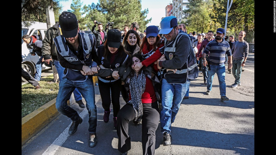 Turkish police officers detain Sebahat Tuncel, a Kurdish politician and former member of Parliament, at a demonstration in Diyarbakir, Turkey, on Friday,  November 4.