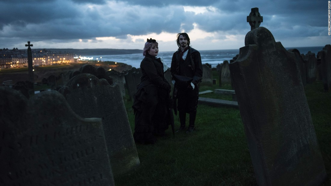 People attend the Whitby Goth Weekend festival in Whitby, England, on Sunday, November 6. The biannual music event brings together thousands of goths and alternative lifestyle fans from the United Kingdom and around the world.