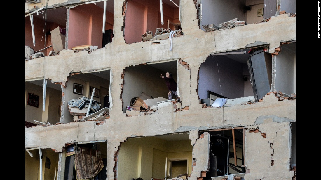 "A woman reacts in her damaged apartment after an explosion in Diyarbakir, Turkey, on Friday, November 4. <a href=""http://www.reuters.com/article/us-turkey-security-blast-idUSKBN12Z0G2?il=0"" target=""_blank"">According to Reuters</a>, Kurdish militants set off a car bomb, killing eight people and wounding more than 100."
