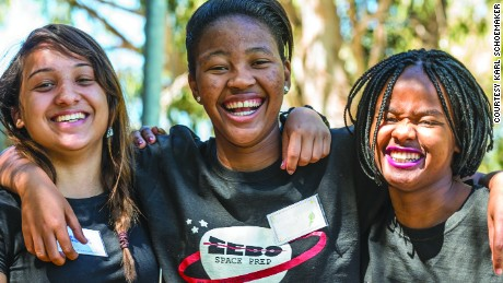 Teen girls in South Africa design the continent's first private space satellite to orbit in 2017. Pictured: Ayesha, Sesam and Banekazi on a learning boot camp in Worcester, Western Cape Province, South Africa.