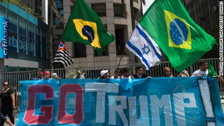 Supporters of US presidential candidate Donald Trump rally in Sao Paulo, Brazil on October 29, 2016. / AFP / NELSON ALMEIDA        (Photo credit should read NELSON ALMEIDA/AFP/Getty Images)