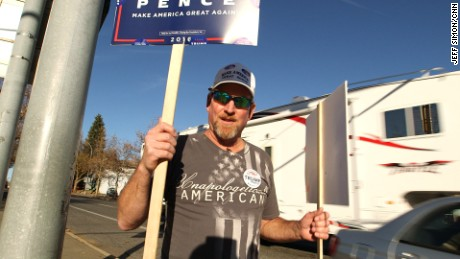 Steve Piper, 55, of Troy, Idaho, holds Trump-Pence signs on a corner in Moscow, Idaho on Election Day.