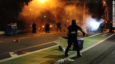 Portland police said they used pepper spray to disperse protesters after the demonstrators threw things at the officers.