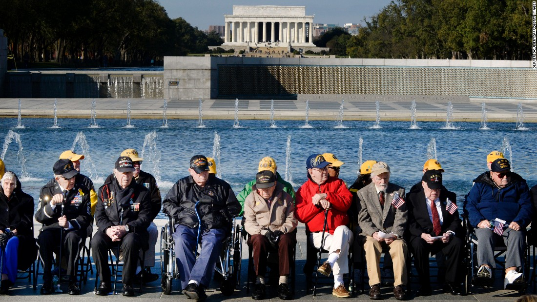 World War II veterans attend a ceremony at the National World War II Memorial in Washington on November 11.