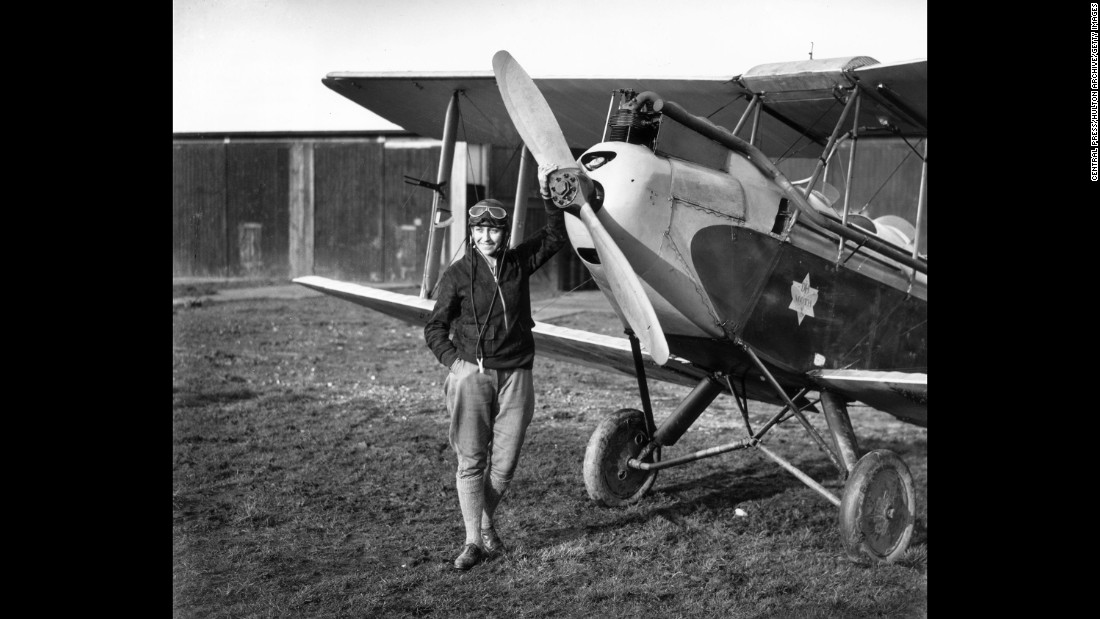 English aviator Amy Johnson standing in front of her Gipsy Moth just before she undertook a 19-day solo flight to Australia.  Johnson was a pioneering English aviator and was the first female pilot to fly alone from Britain to Australia in 1930.