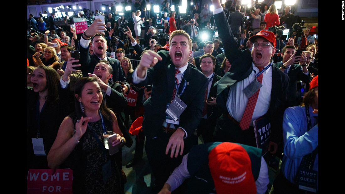 """Donald Trump supporters cheer as they watch election results in New York on Tuesday, November 8. Entering <a href=""""http://www.cnn.com/2016/11/08/politics/gallery/election-day-2016/index.html"""" target=""""_blank"""">Election Day,</a> Trump's chances of winning were seen as remote; most polls showed Hillary Clinton with marginal but steady leads. But Trump swept swing states such as Florida and North Carolina and pulled off unexpected wins in Wisconsin and Pennsylvania <a href=""""http://www.cnn.com/2016/11/09/politics/donald-trump-hillary-clinton-popular-vote/"""" target=""""_blank"""">on his way to victory.</a>"""