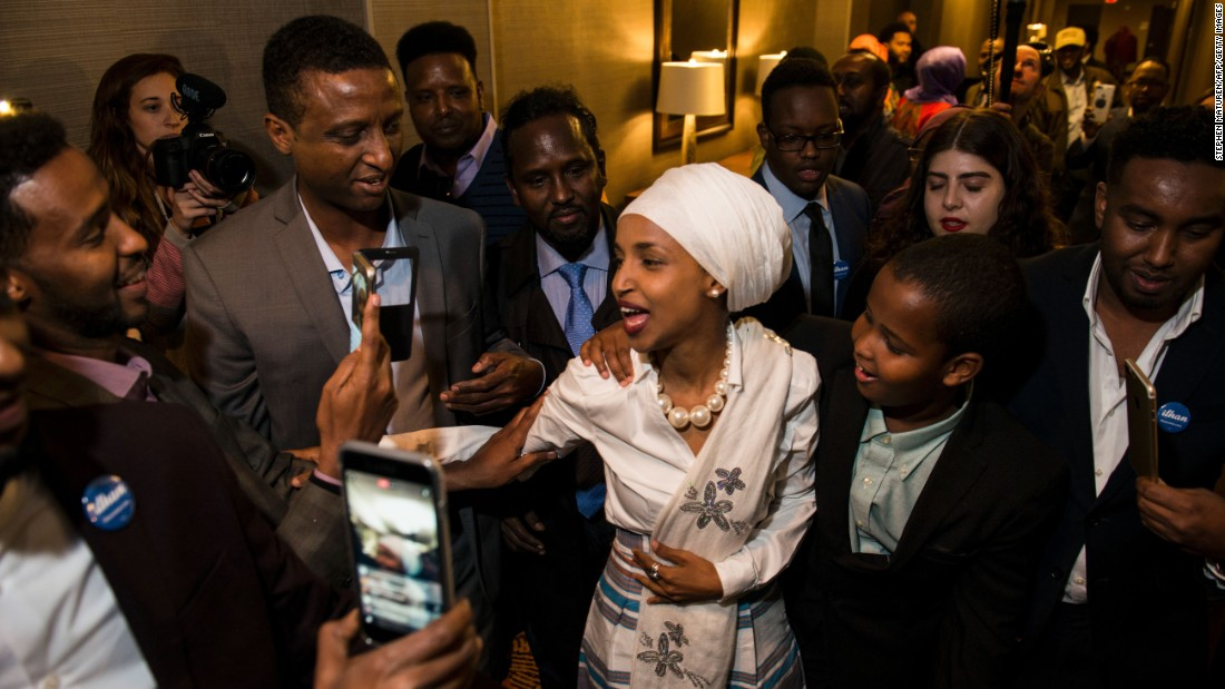 """Ilhan Omar, a candidate for the Minnesota House of Representatives, arrives for her victory party in Minneapolis on Tuesday, November 8. Omar, a former Somali refugee, will be the first Somali-American legislator in the United States. <a href=""""http://www.cnn.com/2016/11/10/politics/us-election-women-who-won/"""" target=""""_blank"""">The women who won: Down-ballot candidates make history</a>"""
