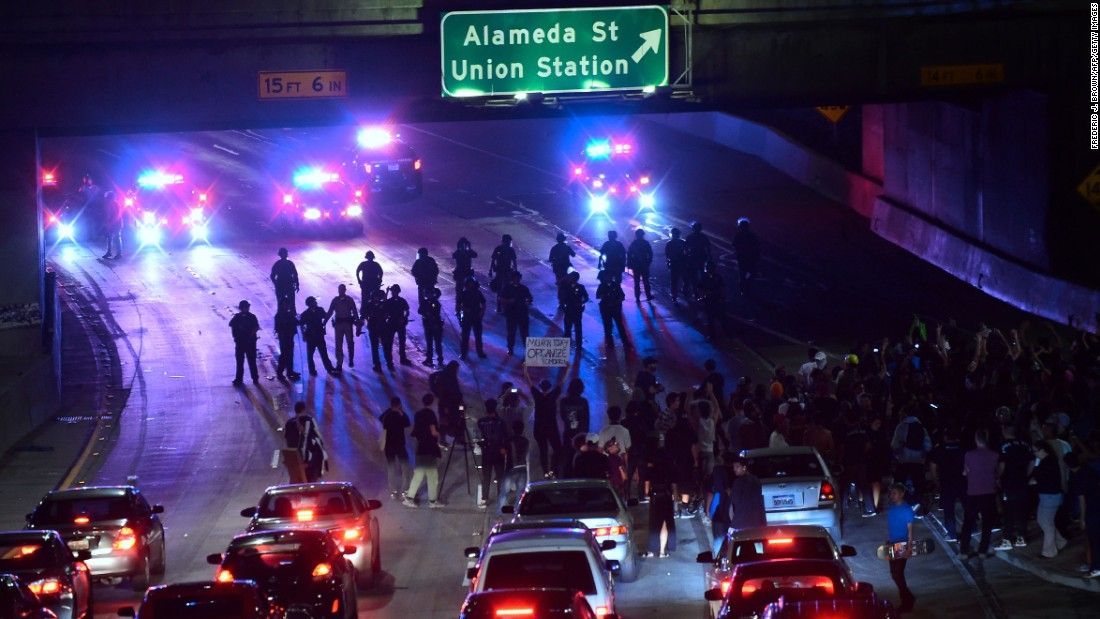 "Police face off with anti-Trump protesters on a freeway in downtown Los Angeles on Thursday, November 10. Nine hours after accusing the media of inciting professional protesters, the President-elect <a href=""http://www.cnn.com/2016/11/10/politics/kellyanne-conway-protesters-donald-trump-2016-election/"" target=""_blank"">reversed course</a> on Friday, November 11, praising those same protesters as having ""passion for our great country."""
