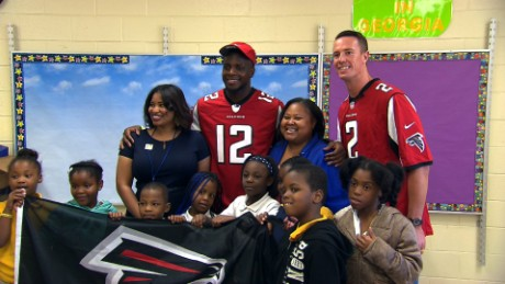 NFL QB surprises teachers & students