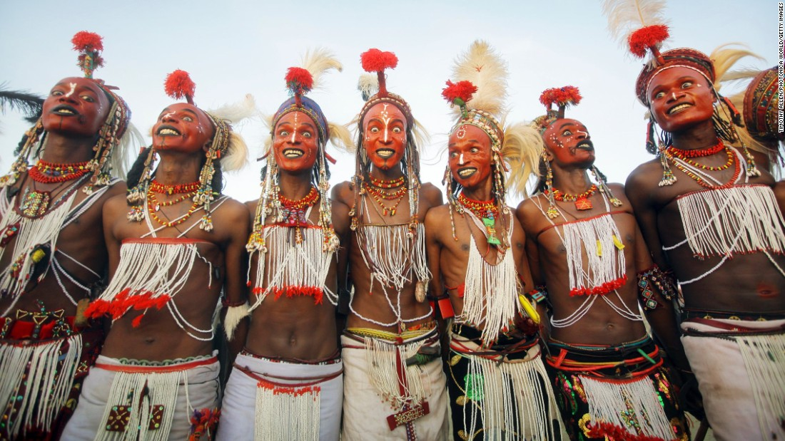 "At the end of the rainy season near Lake Chad, northern Niger, Wodaabe people come together for <em>Cure Salee</em>, the ""Festival of Nomads."" At the center of celebrations is <em>Gerewol</em>, a male beauty contest and courtship ritual. Young men -- traditionally herdsmen -- wear full makeup, jewelry and their finest clothes and stand in line to await inspection by female onlookers. White teeth and white eyes are highly prized, so participants will grin broadly and pull all manner of expressions in the hope of attracting attention. It's flirtation <em>en masse</em>, in the hope of winning a night of passion with one of the judges."