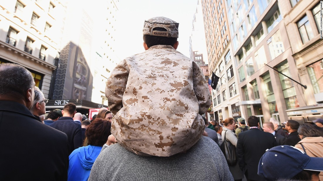 A boy sits on his father's shoulders during the Veterans Day parade in New York on November 11.