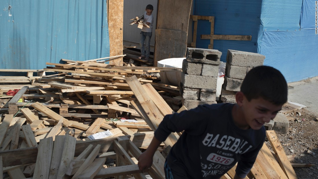 Boys help out in a carpentry shop at Ashti camp. The Christian families want to return home to rebuild, but many have lost hope for a decent future in Iraq.