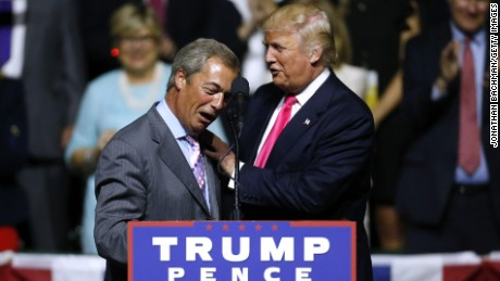 Republican Presidential nominee Donald Trump, right, greets United Kingdom Independence Party leader Nigel Farage during a campaign rally at the Mississippi Coliseum on August 24, 2016 in Jackson, Mississippi.